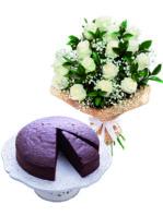 Rose bianche e torta al cioccolato.