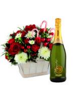 cesto di fiori natalizi con Champagne