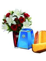 Rose rosse lilium e pandoro
